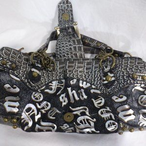 Very cool looking handbag.  Black, silver, buckle
